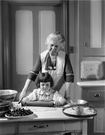 simsearch:846-02793283,k - 1920s 1930s GRANDMOTHER BAKING CHERRY PIE TEACHING GRANDDAUGHTER TO USE ROLLING PIN Stock Photo - Rights-Managed, Code: 846-06111869