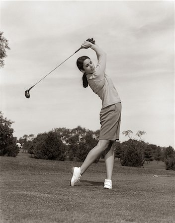 1960s WOMAN PLAYING GOLF TEEING OFF GOLF BALL FROM TEE WITH DRIVER SUMMER OUTDOOR Stock Photo - Rights-Managed, Code: 846-06111862