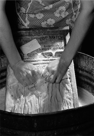 1920s 1930s 1940s CLOSE-UP OF WOMAN'S HANDS SCRUBBING CLOTHES ON WASHBOARD Stock Photo - Rights-Managed, Code: 846-06111894