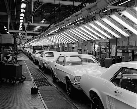 1960s INTERIOR OF FORD MUSTANG PLANT WITH NEARLY FINISHED CARS ON ASSEMBLY LINE Stock Photo - Rights-Managed, Code: 846-06111909