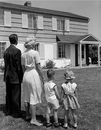 1950s 1960s FAMILY FATHER MOTHER SON DAUGHTER STANDING TOGETHER LOOKING AT SUBURBAN HOUSE Stock Photo - Rights-Managed, Code: 846-06111920