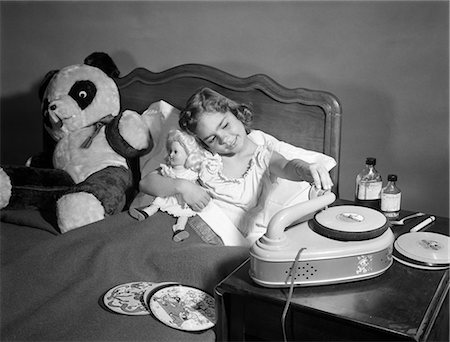 1950s SICK LITTLE GIRL IN BED PLAYING WITH RECORD PLAYER Stock Photo - Rights-Managed, Code: 846-06111990