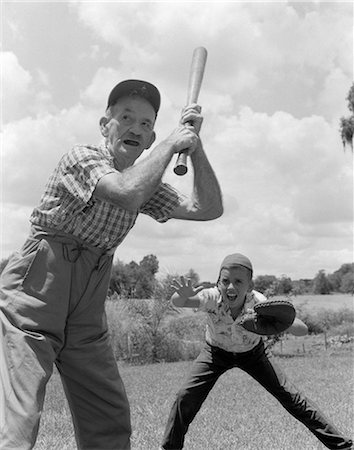 pre-teen boy models - 1950s GRANDFATHER AT BAT WITH BOY AS CATCHER PLAYING BASEBALL Stock Photo - Rights-Managed, Code: 846-06111991