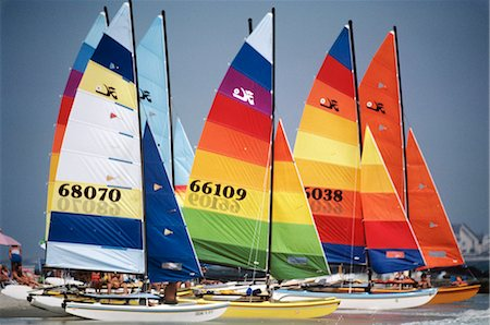 sports and sailing - 1980 1980s RETRO GROUP OF SAILBOATS WITH COLORFULLY STRIPED SAILS IN WATER Stock Photo - Rights-Managed, Code: 846-06112127