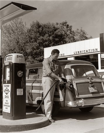 1950s SERVICE STATION ATTENDANT MAN FILLING GAS TANK OF WOOD BODY STATION WAGON Stock Photo - Rights-Managed, Code: 846-06112158
