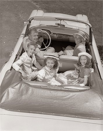 1960s FAMILY PORTRAIT FATHER MOTHER SON TWO DAUGHTERS IN CONVERTIBLE CAR OUTDOOR LOOKING UP AT CAMERA Stock Photo - Rights-Managed, Code: 846-06112150