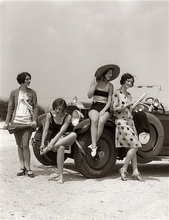 1920s GROUP OF FOUR WOMEN AT SHORE GATHERED AROUND CONVERTIBLE TWO IN DRESSES & TWO IN BATHING SUITS Stock Photo - Rights-Managed, Code: 846-06112152