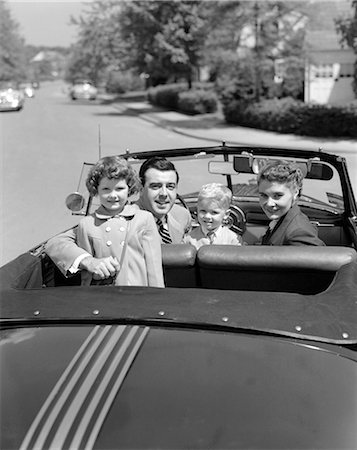 1950s PORTRAIT WELL DRESSED FAMILY MOM DAD SON DAUGHTER IN CONVERTIBLE CAR TOP DOWN LOOKING AT CAMERA OVER BACK OF TRUNK Stock Photo - Rights-Managed, Code: 846-06112161