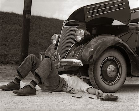 stalled car - 1930s MAN ON BACK WEARING STRIPED SOCKS FIXING CAR Stock Photo - Rights-Managed, Code: 846-06112175