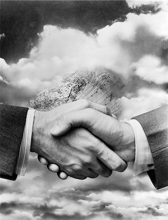 1940s BUSINESSMEN'S HANDS IN HANDSHAKE SUPERIMPOSED ON BACKGROUND OF GLOBE BURIED AMONG CLOUDS Stock Photo - Rights-Managed, Code: 846-06112411