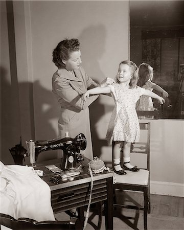 1950s MOTHER ADJUSTING FIT OF HOME SEWN DRESS ON YOUNG DAUGHTER BY SEWING MACHINE Stock Photo - Rights-Managed, Code: 846-06112473