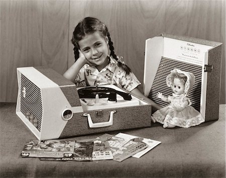 1950s SMILING GIRL LISTENING TO PORTABLE RECORD PLAYER LOOKING AT CAMERA Stock Photo - Rights-Managed, Code: 846-07200058