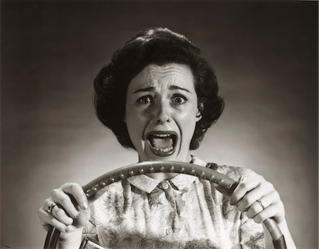 people in panic - 1950s SCREAMING FRIGHTENED WOMAN HOLDING ON TO STEERING WHEEL DRIVING CAR Stock Photo - Rights-Managed, Code: 846-07200072