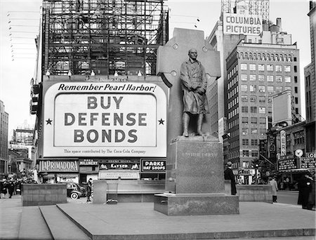1940s BUY DEFENSE BONDS BILLBOARD AT STATUE OF FATHER DUFFY OF THE FIGHTING 69th OF WORLD WAR I AT TIMES SQUARE NEW YORK CITY Stock Photo - Rights-Managed, Code: 846-07200137