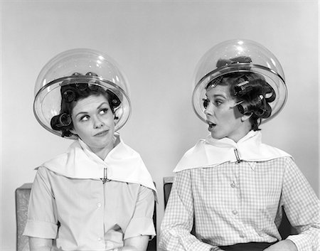 retro beauty salon images - 1960s TWO WOMEN SITTING UNDER SALON HAIRDRYERS GOSSIPING TALKING Stock Photo - Rights-Managed, Code: 846-07200140