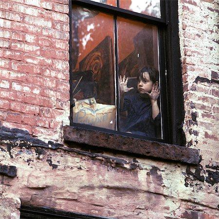 sad child sitting - 1960s 1970s SINGLE SAD LITTLE GIRL SITTING IN WINDOW OF WORN URBAN BRICK BUILDING Stock Photo - Rights-Managed, Code: 846-07760707