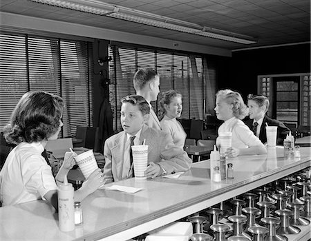 1950s YOUNG TEENAGE GIRLS AND BOYS DRINKING MILKSHAKES SITTING AT SODA FOUNTAIN COUNTER Stock Photo - Rights-Managed, Code: 846-07760709