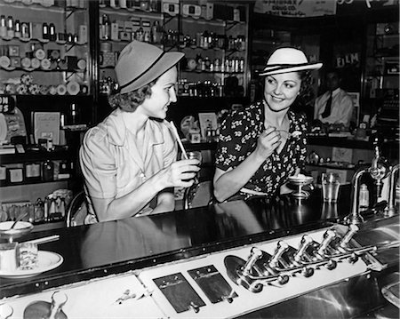 1930s TWO WOMEN DRINKING SODAS EATING ICE CREAM AT SODA SHOP COUNTER Stock Photo - Rights-Managed, Code: 846-07760710