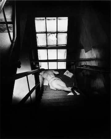 dead female body - 1950s WOMAN LYING AT BOTTOM OF DARK STAIRCASE HAVING FALLEN DOWN STAIRS Stock Photo - Rights-Managed, Code: 846-07760759