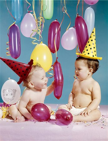 1960s TWO BABY GIRLS WEARING PARTY HATS WITHBALLOONS Stock Photo - Rights-Managed, Code: 846-08030371