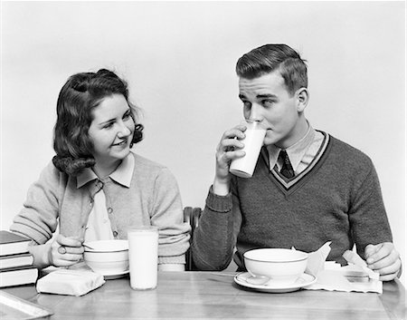 """1940s TEENAGE GIRL AND BOY EATING SCHOOL LUNCH SOUP SANDWICHES TOGETHER BOY DRINKING MILK Stock Photo - Rights-Managed, Code: 846-08140037"
