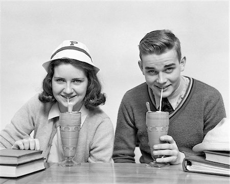 1940s TEENAGE BOY AND GIRL DRINKING MILKSHAKES TOGETHER LOOKING AT CAMERA Stock Photo - Rights-Managed, Code: 846-08140038