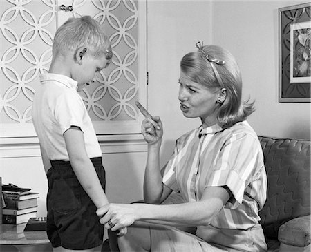 1970s MOTHER DISCIPLINING HER SON BY TALKING HARSHLY AND SHAKING HER FINGER BOY HANGING HIS HEAD IN SHAME Stock Photo - Rights-Managed, Code: 846-08140045