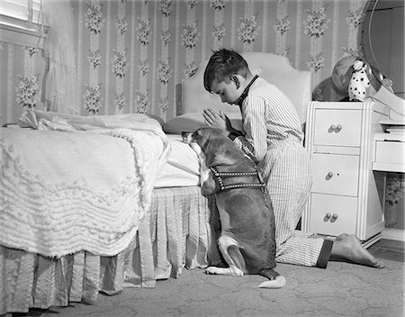 1950s BOY & DOG PRAYING AT BEDSIDE Stock Photo - Rights-Managed, Code: 846-08140047