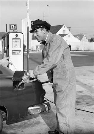 1950s SERVICE STATION ATTENDANT MAN IN STRIPED OVERALLS & CAP FILLING GAS TANK OF AUTOMOBILE Stock Photo - Rights-Managed, Code: 846-08140080
