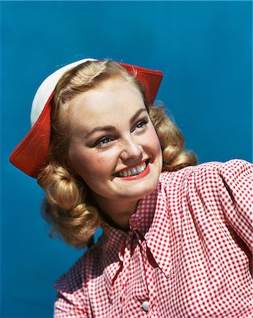 1940s 1950s PORTRAIT SMILING BLOND TEENAGE GIRL WEARING RED AND WHITE CHECKED BLOUSE AND DUTCH STYLE HAT Stock Photo - Rights-Managed, Code: 846-08140092