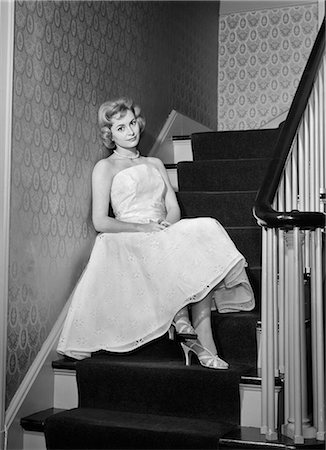 1950s 1960s WOMAN FORMAL COCKTAIL DRESS SITTING ON STAIRS LOOKING SAD WAITING FOR DATE STOOD UP Stock Photo - Rights-Managed, Code: 846-08140107
