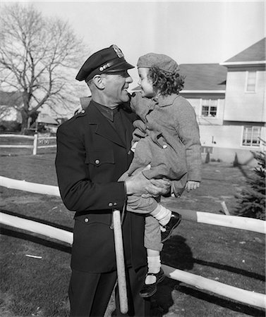 female police officer happy - 1950s POLICEMAN CARRYING YOUNG GIRL Stock Photo - Rights-Managed, Code: 846-08140100