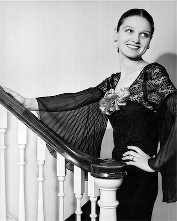 erotic female figures - 1930s WOMAN WEARING SPANISH STYLE DRESS WITH LACE & FULL CHIFFON SLEEVES SMILING STANDING ON STAIRCASE LOOKING BACK Stock Photo - Rights-Managed, Code: 846-08226087