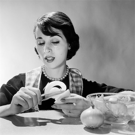 simsearch:846-02793283,k - 1950s 1960s WOMAN HOUSEWIFE COOK REACTING TO PEELING ONION CRYING TEARS Stock Photo - Rights-Managed, Code: 846-08226101