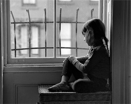 sad girls - 1960s SAD LONELY GIRL LOOKING OUT THROUGH CITY APARTMENT WINDOW WITH METAL SECURITY BARS Stock Photo - Rights-Managed, Code: 846-08226110