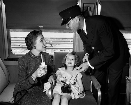 1950s MOTHER AND DAUGHTER ON TRAIN WITH CONDUCTOR PUNCHING THEIR TICKET Stock Photo - Rights-Managed, Code: 846-08226149