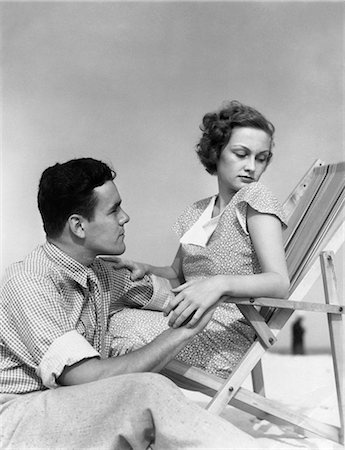 sad lovers break up - 1930s COUPLE LOVERS QUARREL WOMAN IN BEACH CHAIR HEAD TURNED AWAY FROM MAN SITTING BESIDE HER Stock Photo - Rights-Managed, Code: 846-08226153