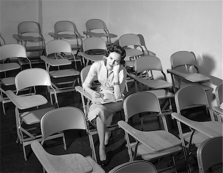 1950s WOMAN SITTING IN CLASSROOM OF EMPTY CHAIRS ANNOYED Stock Photo - Rights-Managed, Code: 846-08226175