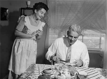 simsearch:846-02793283,k - 1950s HUSBAND EATING DINNER AS WIFE LOOKS ON Stock Photo - Rights-Managed, Code: 846-08512683
