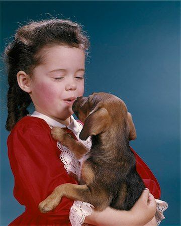 dog kissing girl - 1960s LITTLE GIRL KISSING HER BEAGLE PUPPY Stock Photo - Rights-Managed, Code: 846-08512710