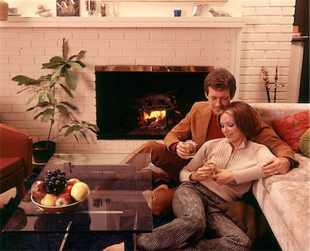 1970s ROMANTIC COUPLE MAN AND WOMAN HAVING DRINKS BY FIREPLACE SITTING ON FLOOR Stock Photo - Rights-Managed, Code: 846-08512713
