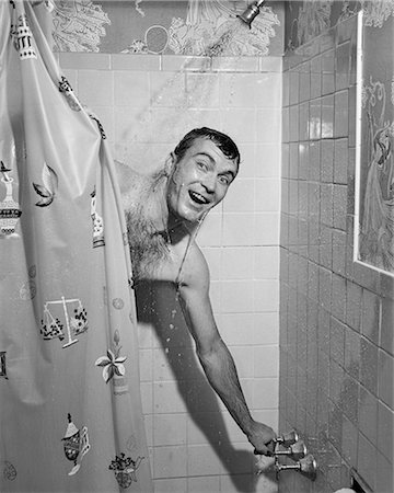 1950s MAN IN SHOWER TURNING ON WATERAND PULLING SHOWER CURTAIN CLOSED Stock Photo - Rights-Managed, Code: 846-08639474