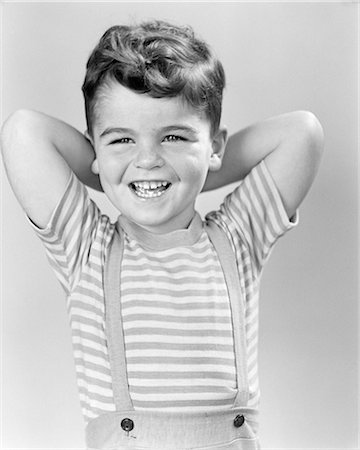 1940s PORTRAIT SMILING LAUGHING BOY ARMS REACHING BEHIND HEAD WEARING STRIPED SHIRT Stock Photo - Rights-Managed, Code: 846-08639541