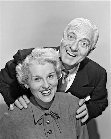1950s SMILING PORTRAIT MIDDLE-AGED COUPLE MAN STANDING ABOVE WOMAN WITH HANDS ON HER SHOULDERS Stock Photo - Rights-Managed, Code: 846-08639565