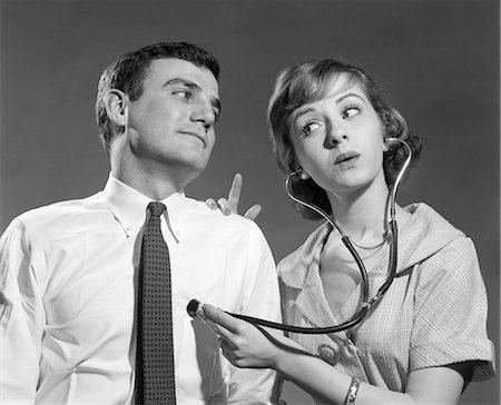 1960s WIFE WITH STETHOSCOPE ON HUSBAND Stock Photo - Rights-Managed, Code: 846-08639571
