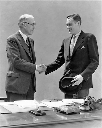 1930s TWO MEN STANDING AT DESK IN OFFICE SHAKING HANDS Stock Photo - Rights-Managed, Code: 846-08721116