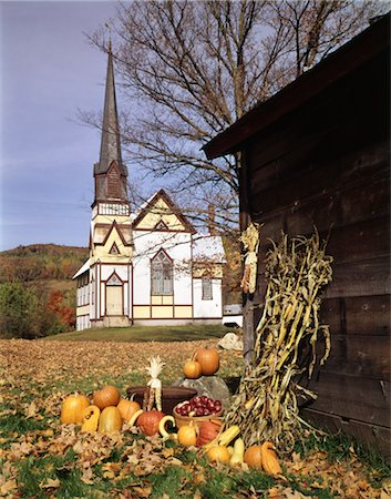 1960s CHURCH IN AUTUMN GOURDS PUMPKINS BASKETS OF APPLES DRIED CORN EAST ORANGE VT NEW ENGLAND SCENIC Stock Photo - Rights-Managed, Code: 846-02794113