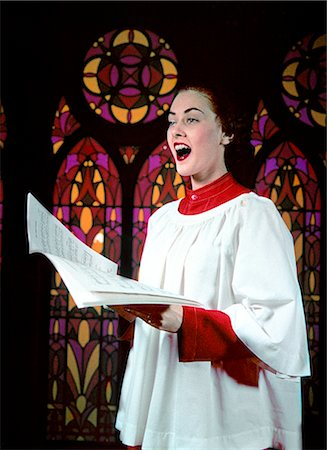 1950s WOMAN SINGING CHOIR ROBE STAINED GLASS BACKGROUND Stock Photo - Rights-Managed, Code: 846-02794145