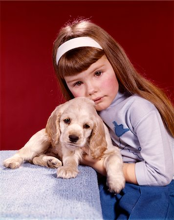 sad girls - 1970s PORTRAIT SERIOUS LITTLE GIRL HUGGING HER COCKER SPANIEL PUPPY DOG Stock Photo - Rights-Managed, Code: 846-02794161