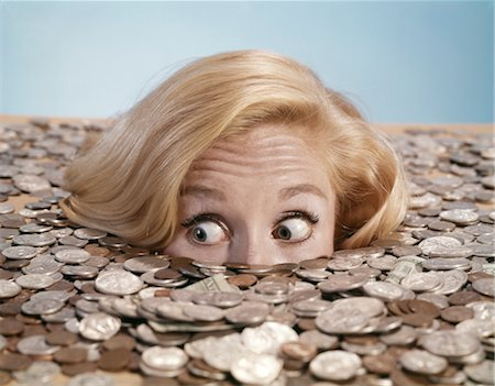 1960s STARTLED BUG-EYED BLOND YOUNG WOMAN BURIED UP TO HER NOSE IN PILE OF COINS AND CURRENCY Stock Photo - Rights-Managed, Code: 846-02794267